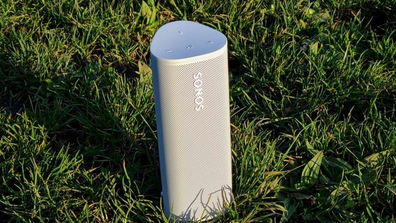 Sonos Roam set upright in a field