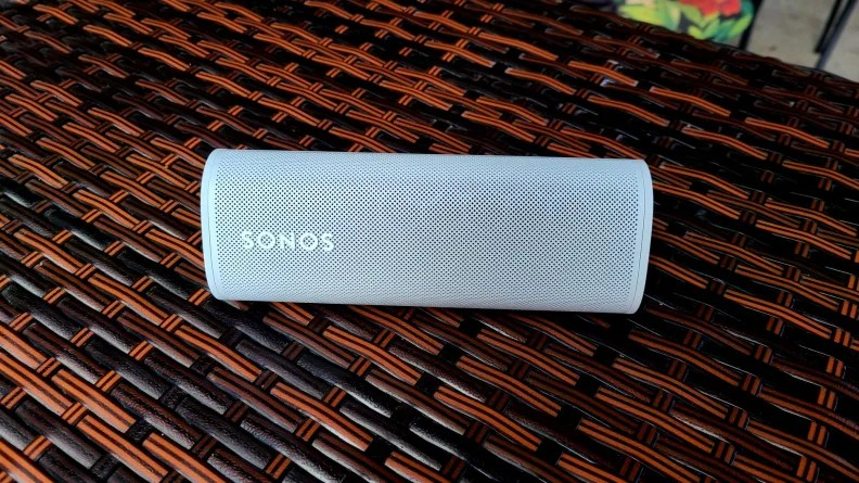 Sonos Roam set against vinyl