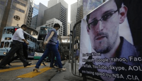 Edward Snowden's recognizable image displayed on a Hong Kong street.