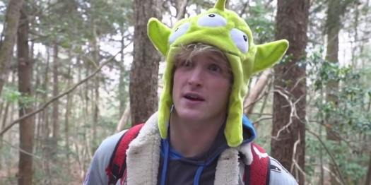 Logan Paul, probably stifling a laugh, in the suicide forest.