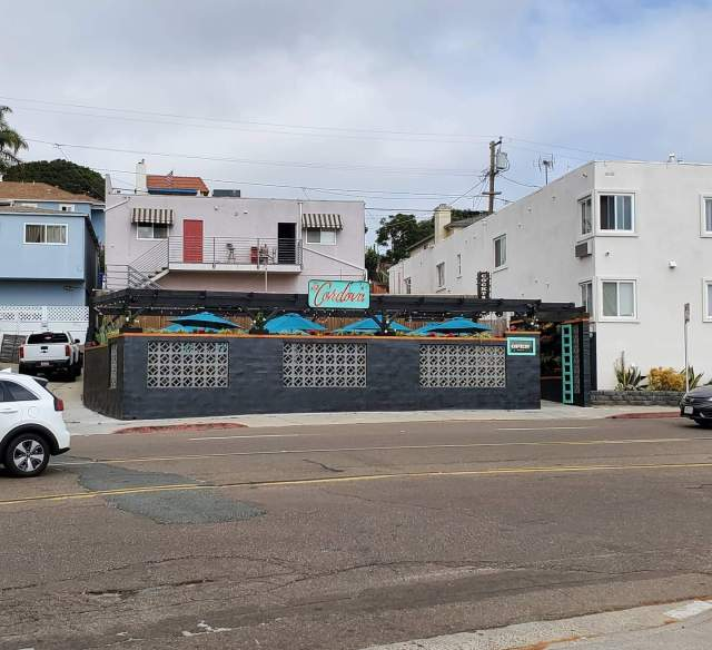 The Cordova as it looks now with the pandemic patio that appears to be installed where the parking spaces were out front, at what was formerly The Morena Club. Photo, Reviewer Rob.