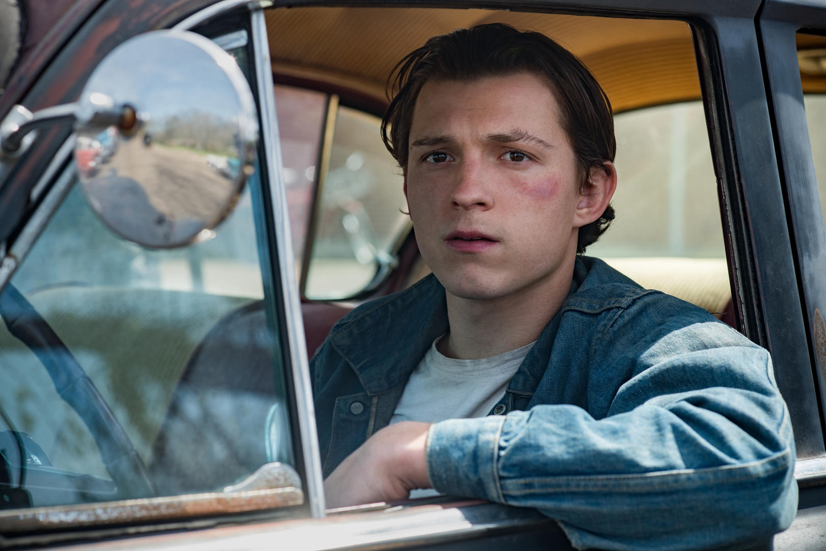 The Devil All The Time, Tom Holland as Arvin Russell. Photo Cr. Glen Wilson/Netflix © 2020