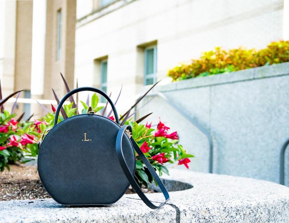 the daily edited circle crossbody bag black