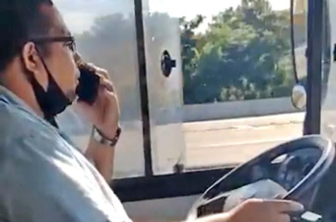 Vídeo: Motorista de ônibus dirige falando ao telefone na Linha Amarela e vídeo viraliza