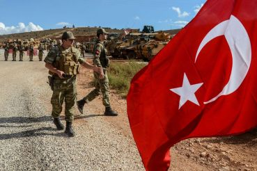 Erdogan anuncia início da missão na Síria com Putin. Crédito: llyas Akengin/AFP via Getty Images/Bloomberg.