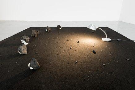 Julia Llerena, Carbón (Coal), 2017, Broken teacups, coal, lamp and carpet, variable dimensions