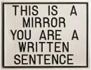 Vista de sala de la exposición Luis Camnitzer, Hospicio de utopías fallidas. This is a mirror, you are a written sentence (Este es un espejo, tú eres una frase escrita), 1966-1968. Poliestireno formado al vacío. 48,4 x 62,5 x 1,5 cm. Daros Latinoamérica Collection, Zürich