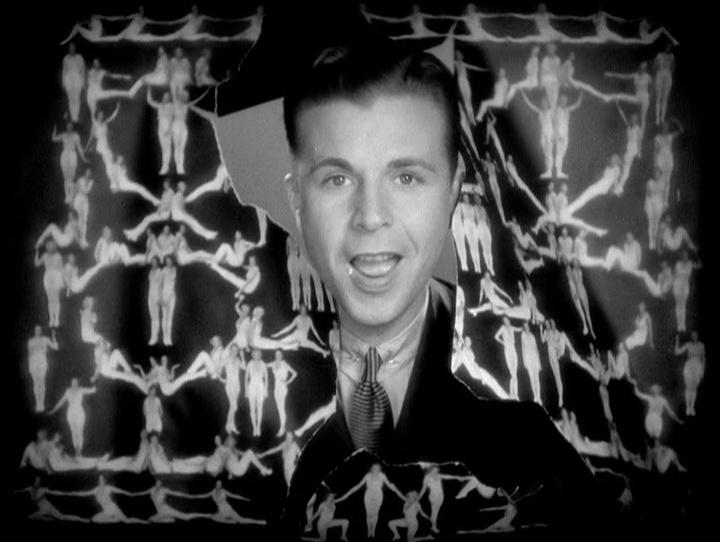 """Dick Powell """"penetra"""" e rasga o cartaz das dançarinas no número final de Dames"""