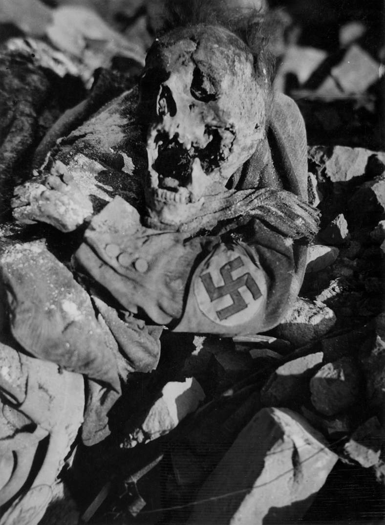 The dead body of a stormtrooper from Hitler's paramilitary Sturmabteilung (SA) is pictured inside a so-called bomb shelter in the John street in Dresden