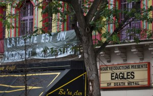 """A banner reading """"Freedom is a monument which can not be destroyed"""" on the facade of the Bataclan concert hall which hosted the Eagles of Death Metal during the terrorist attack last Friday, in Paris, Tuesday, Nov. 17, 2015. France is demanding security aid and assistance from the European Union in the wake of the Paris attacks and has triggered a never-before-used article in the EU's treaties to secure it. (AP Photo/Peter Dejong)"""