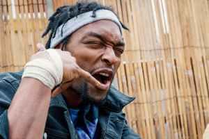 grimacing black man showing call me sign