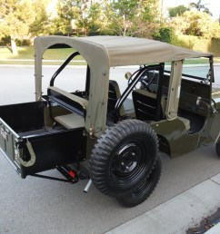 this 1947 willys jeep cj2a has an attachable tray that adds pick up style carrying [ 2048 x 1536 Pixel ]