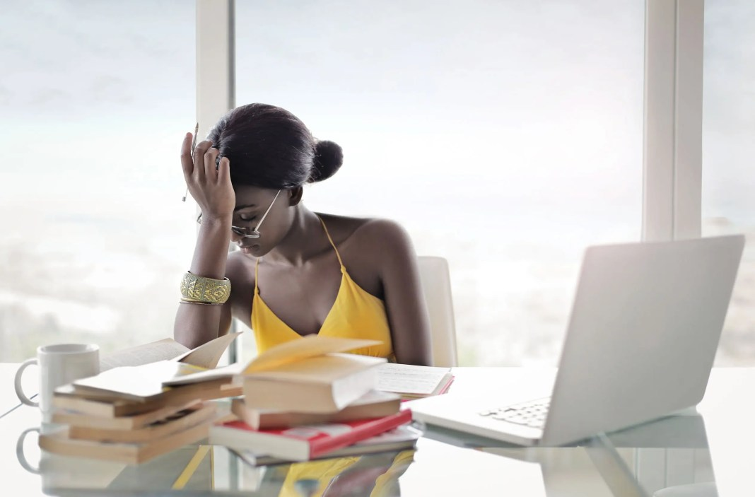 Woman at a busy desk