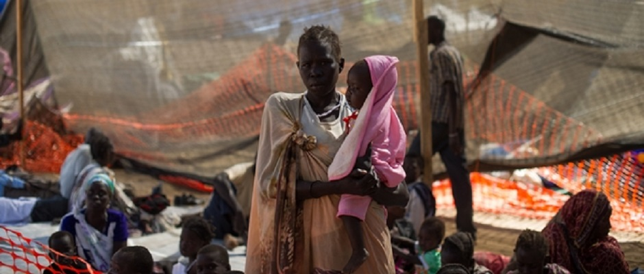 A lady stands with her daughter in the Médecins Sans Frontières (MSF) clinic set up at the camp for  displaced people in the grounds of the United Nations Mission to South Sudan (UNMISS) base in Juba, South Sudan, on January 12, 2014.