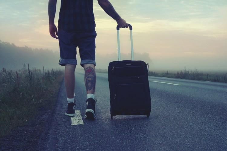 Man w:suitcase