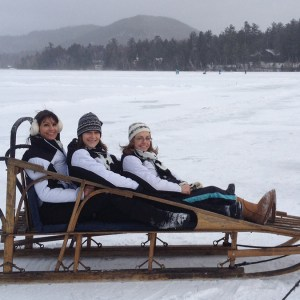 adult synchro skaters ride a dogsled and love synchro