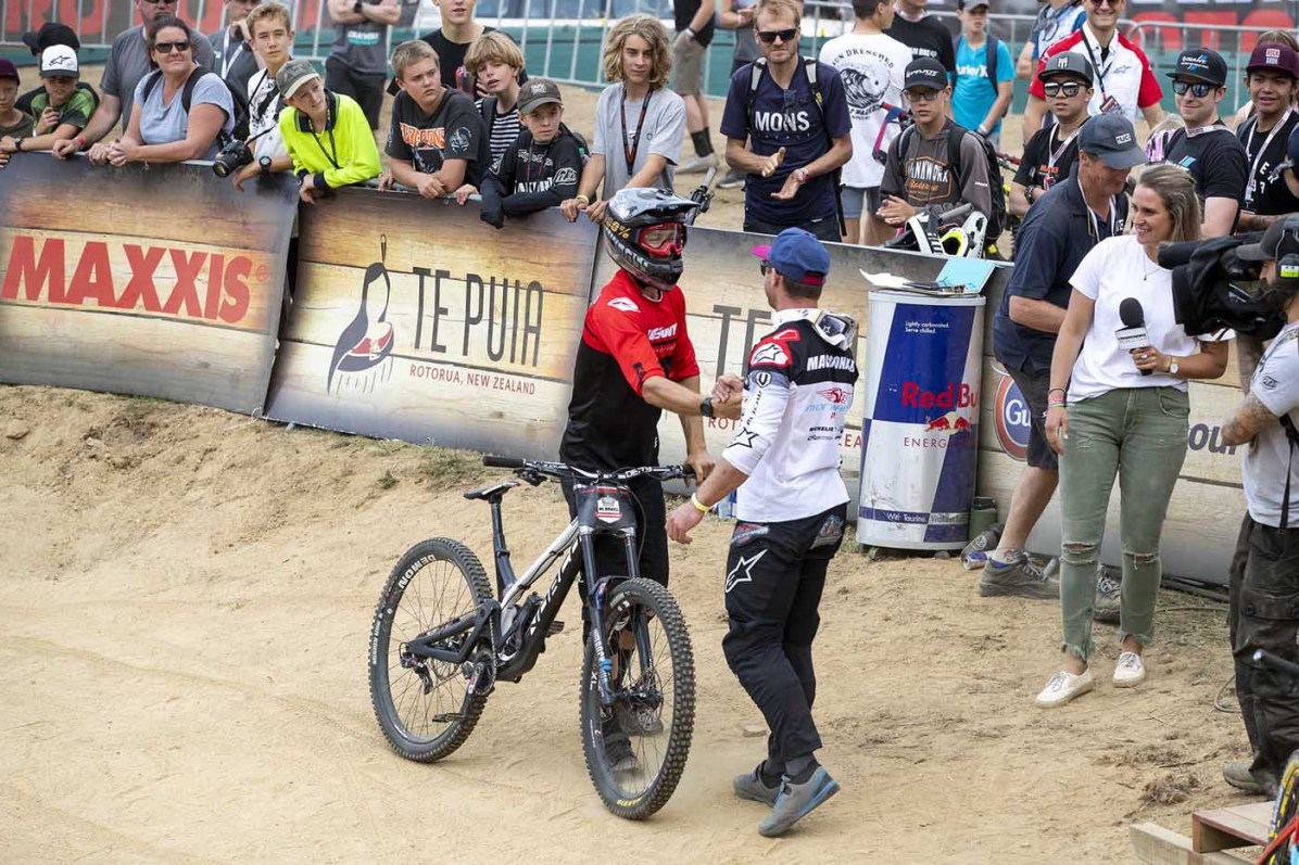 Sam Blenkinsop congratulates Brook MacDonald after the downhill race at the Crankworx FMBA Slopestyle World Championship in Rotorua, New Zealand on March 22, 2019. // Graeme Murray/Red Bull Content Pool // AP-1YT23YZJH1W11 // Usage for editorial use only // Please go to www.redbullcontentpool.com for further information. //