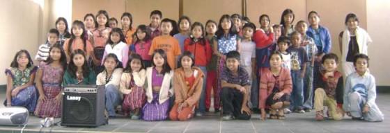 45 children receive their scholarship onstage