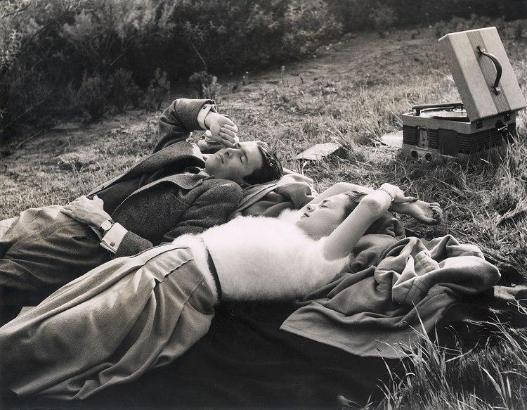 Jimmy Stewart & Olivia De Havilland lying in grass, 1938, Gelatin-silver print