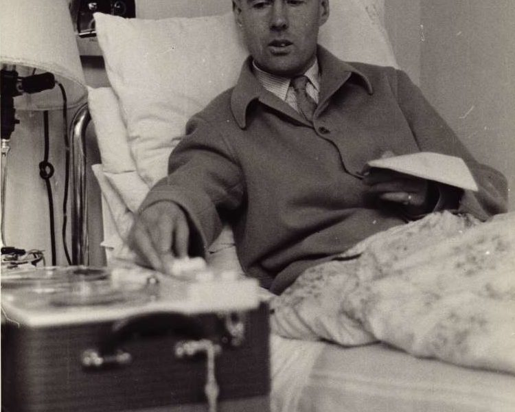 Leonard Cheshire sat up in a hospital bed