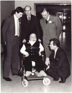 Five men in a posed photo at a film premiere