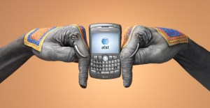 This image is by designer Guido Daniele. The hands have been painted as elephants as part of a promotional campaign for AT&T in India. The image links directly to the cultural stereotype of the elephant as a powerful and reliable mover. In this instance the stereotype is being associated with the movement of information.
