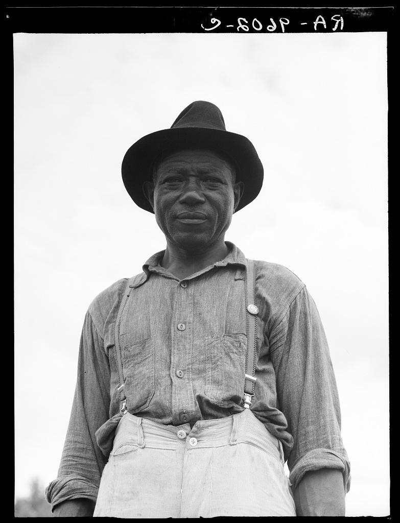At Hill House, Mississippi. He wears the union button Plantation overseer. Mississippi Delta, near Clarksdale, MississippiPresident of the Southern Tenant Farmers Union at Hill House, Mississippi by Dorothea Lange