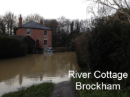 Landlord raised this cottage above 100 year flood risk level: this is a ROAD, not the river!