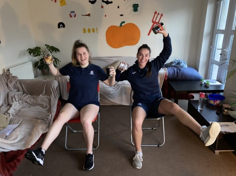 Physio students Izzy and Mairi doing online exercise classes