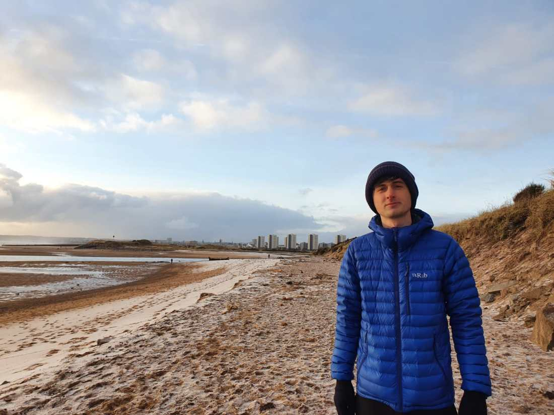 Jack Bryce, BSc Biomedical Science Student at RGU, near the beach