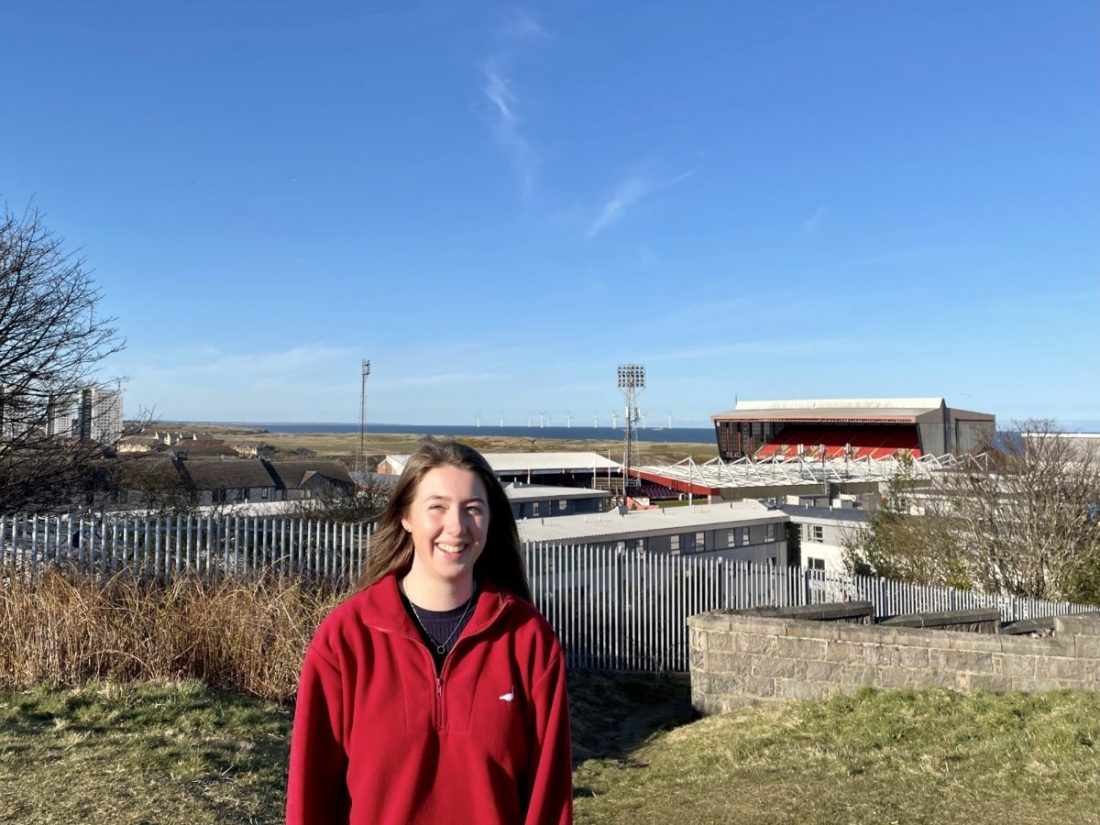 Rachel Hamilton, an RGU placement student at Aberdeen Football Club outside the Pittodrie stadium.