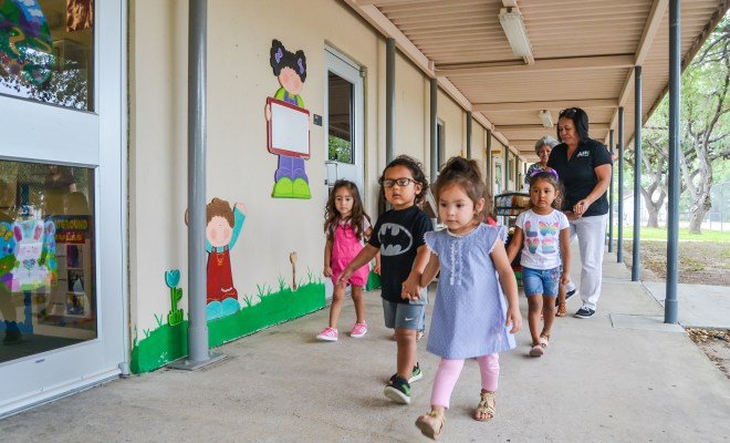 Young children walk hand in hand back to their classrooms after recess at STC's child development center located near the Mid-Valley Campus in Weslaco.  The Department of Childhood Development at South Texas College (STC) received a four year grant from the U.S Department of Education of $929,800 as part of the Child Care Access Means Parents in School Program.