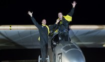 Two triumphant pilots emerge from the cockpit of Solar Impulse 1 as it completed its final cross country leg at JFK in July 2013.