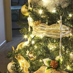 Pictures Of Living Room Decorated For Christmas Navy Blue Couches How To Light, Ribbon, And Decorate A Tree
