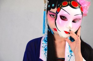 Chinese opera woman removes mask