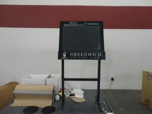 Swivel top and plexiglass tournament sign.