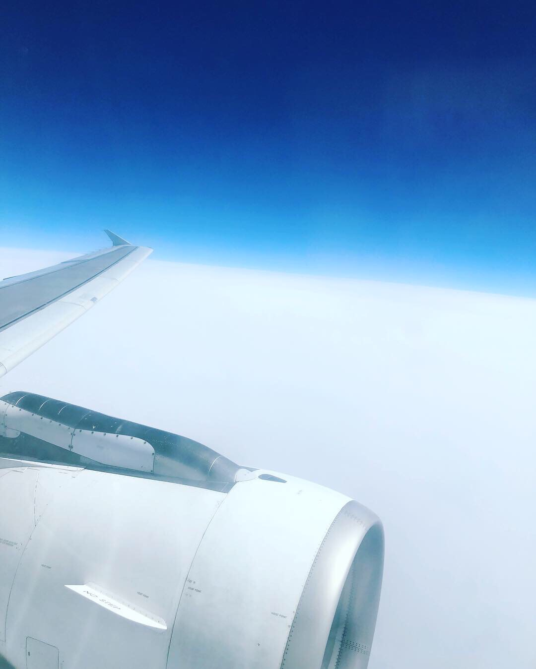 Out the window above the clouds Iberia flight