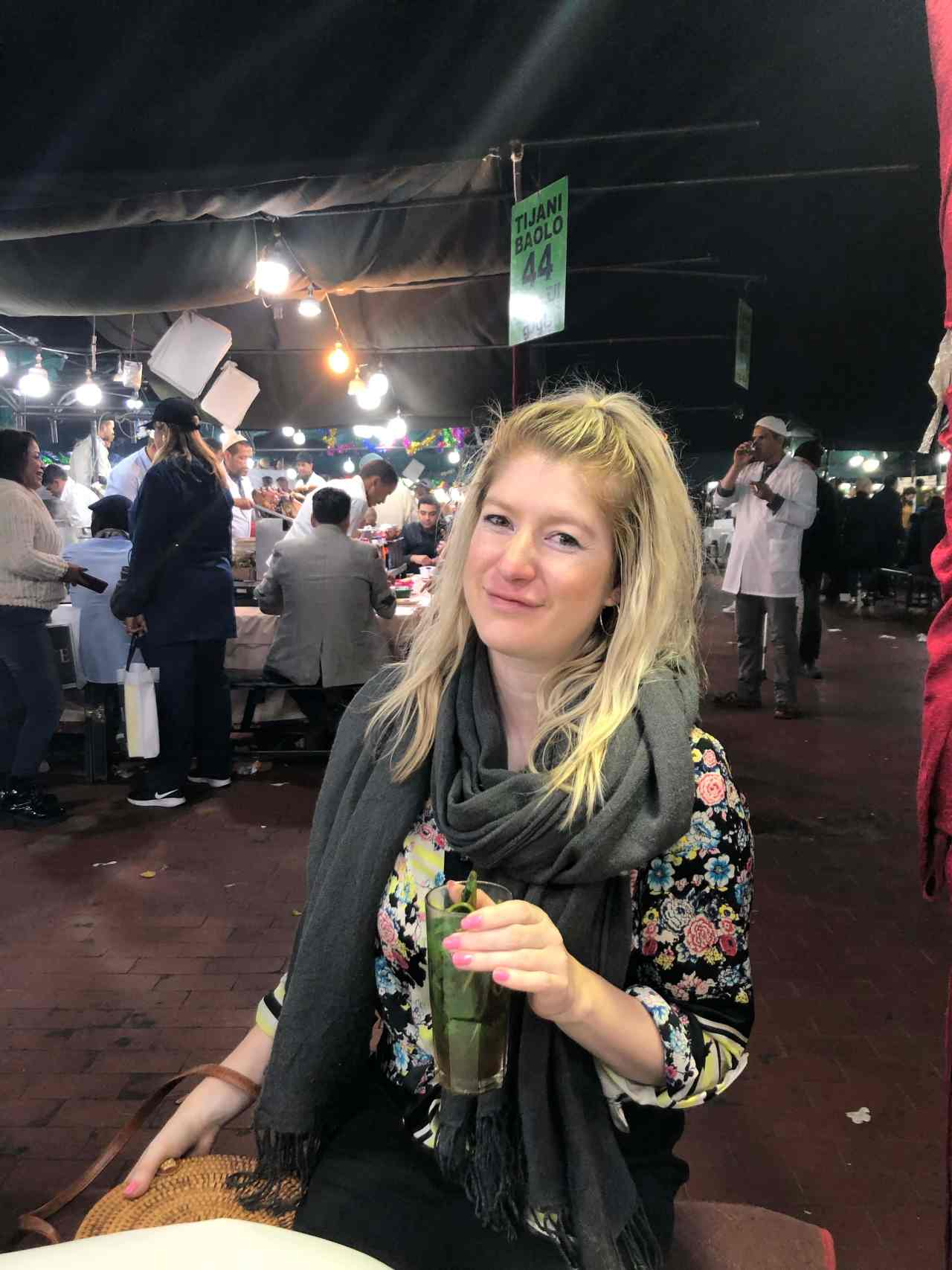 Mint tea in the night time street market in Marrakech amin square