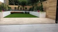 Travertine paving patio render block raised beds hardwood