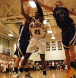 Tyler Gibosn goes up for the rebound.