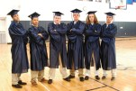 Bryan Tavares, Owen Lund, Conley Sharland, Ryan Totte, Jordan Welch and Jon Lindahl in the gym before graduation.