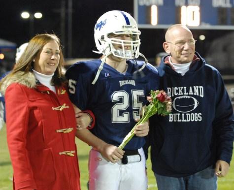 Senior captain Colin Aylward and his mom and dad.
