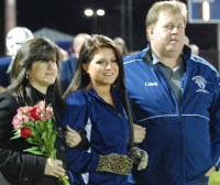 Brie Newcomb and her parents.