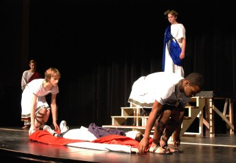 David Wook and Leshon Crawford carry the body of Caesar into the forum.