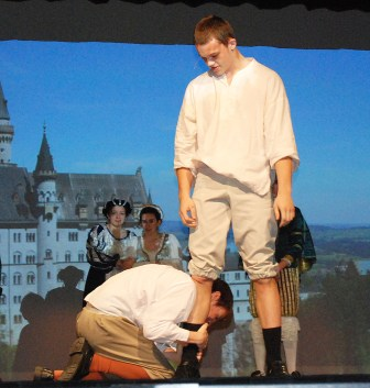Orlando (PJ Butler) pleads with Charles (Bob Gasdia) in this scene from As You LIke It