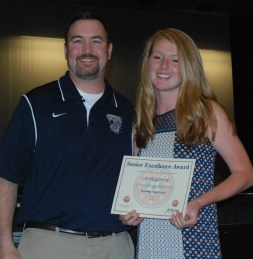 Greg Rowe presents a National Recognition Award to Molly Garrity