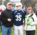 #35 owen Martin with his parents, Lisa and Matt