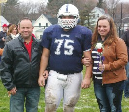 #75 Jean DaSilva escorted by his parents, Rita and Juraci