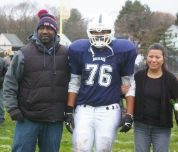 #76 Thomas Conley-Wilson escorted by his parents, Tara and Tom