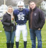 #85 Richard Walls accompanied by his parents, Lori and Frank